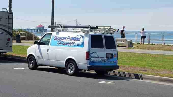 Seashore Plumbing Van by the ocean