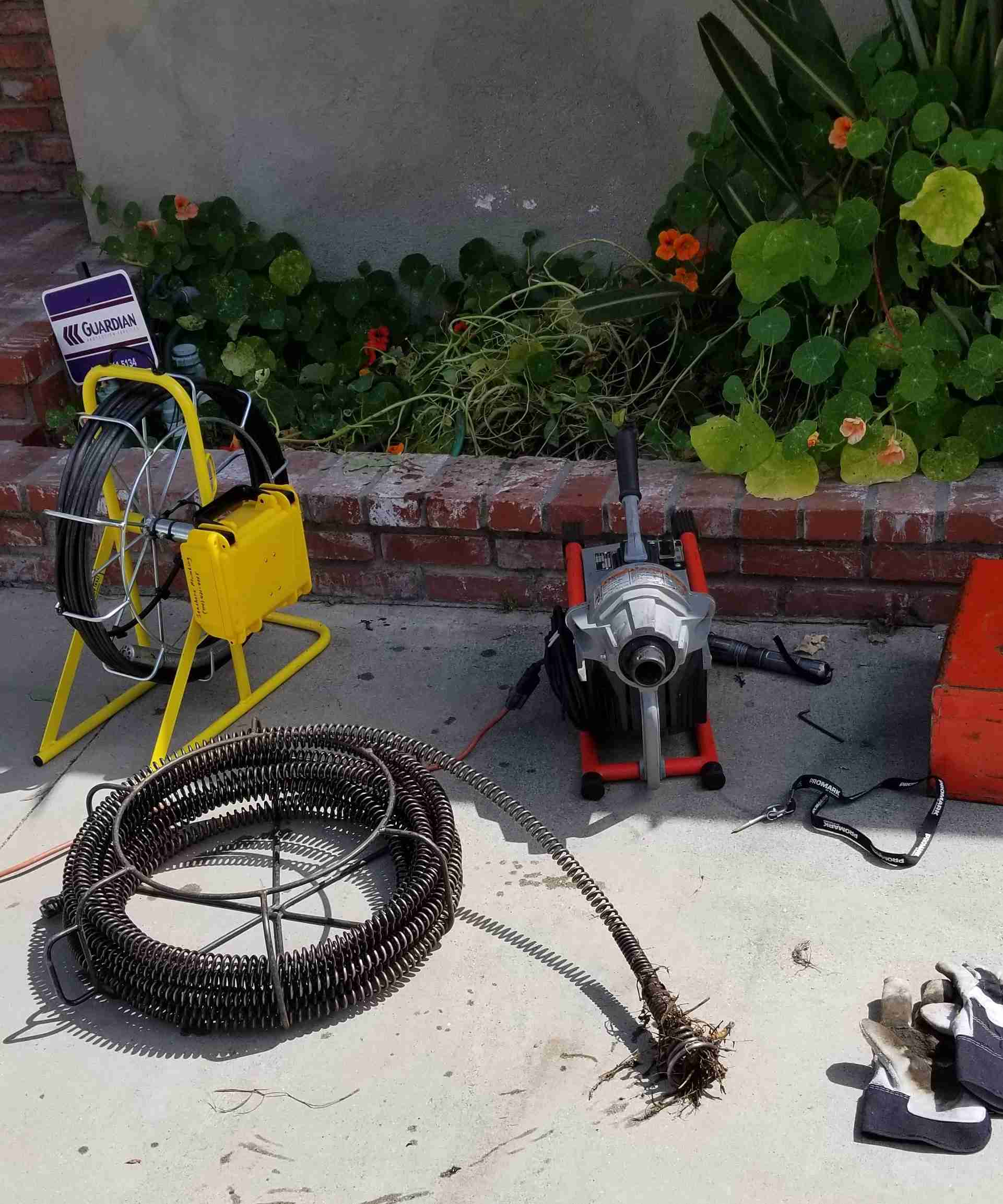 Servicing Sewer and Drain lines with camera and rooter cable